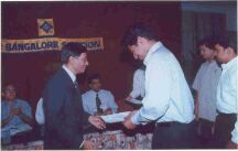 AGM-2000: Prof. Jenkins giving away the Mr BRV Varadan student paper contest prizes